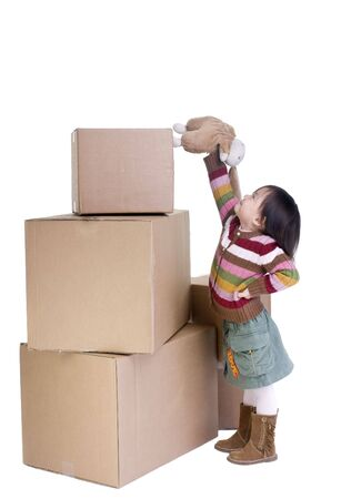 A young asian girl packing up for a move.