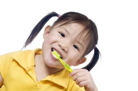 A young girl brushing herteeth. Health and living.