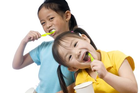oral cavity: Two sisters brushing thier teeth. Health and living.