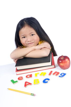 person writing: A young girl is ready for school. Education, Future