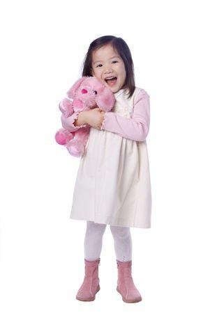 彼女の好きな動物との若いアジアの女の子