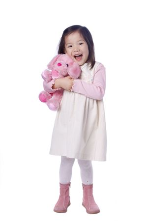 Een jonge Aziatische meisje met haar favoriete dier Stockfoto
