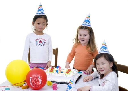 birthday party kids: A group of young children celebrate a birthday party.