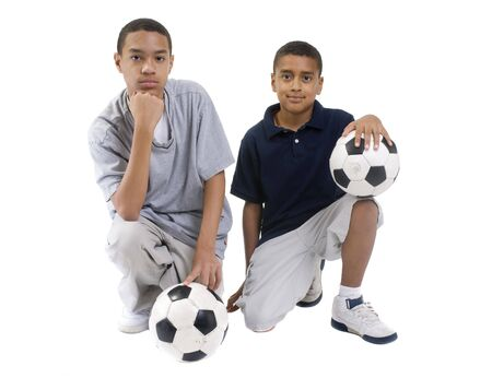 Two african american brothers with soccer balls. teamwork