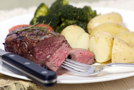 A grilled top sirloin steak .. medium with broccoli and fresh  potatoes Stock fotó