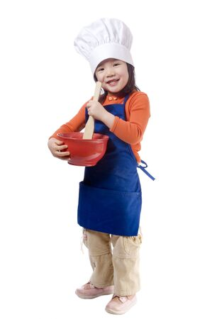A young girl having fun in the kitchen making a mess....I mean making cookies.