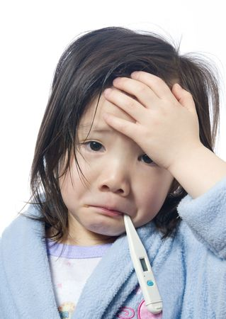 A young girl is sick and having her temperature taken. Stock Photo