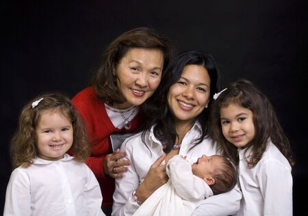 A young mother and daughters and parent with a newborn girl. Family, love, caring. photo