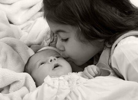 A newborn little girl. Family, love, caring.