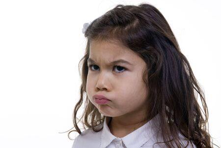 A young girl is pouting about something. Stock Photo