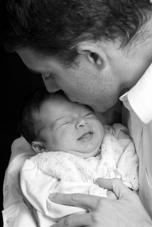 A young man with a newborn girl. Family, love, caring. photo