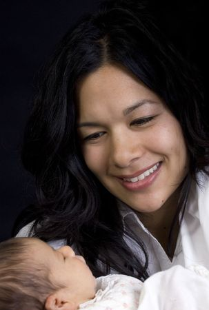 A young woman with a newborn girl. Family, love, caring. photo