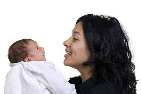 A young women with a newborn girl. Family, love, caring.