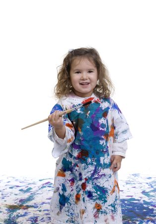 A young  having fun painting on the floor