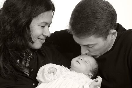A young couple with a newborn girl. Family, love, caring. photo