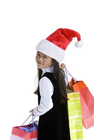 A young girl shopping for xmas presents. Childhood, Christmas. Stock Photo - 3523266
