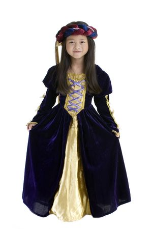 curtsy: A young girl dressed up in royal gown. Childhood, youth, growing up.