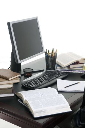 Piles of books open with a computer. Working on a research paper. Stockfoto