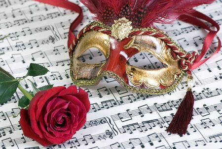 theatre masks: Two beautiful carnivale masks from venice Italy, on a sheet of music.