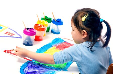 A young asian girl having fun painting a picture Stock Photo