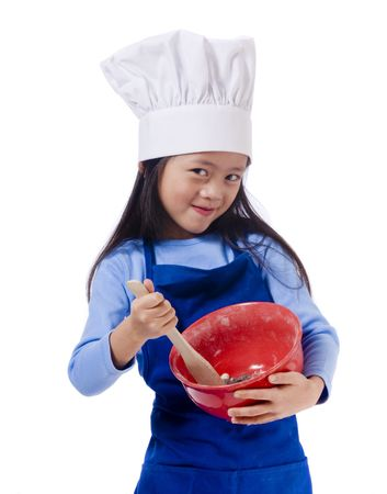 child food: The little chef making a mess in the kitchen Stock Photo