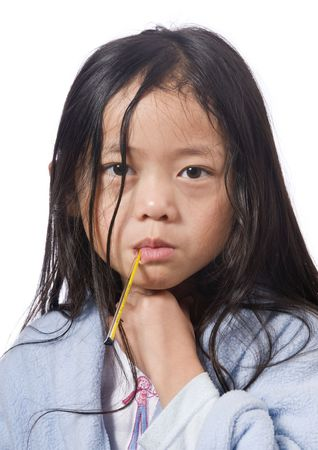 A young asian girl with a thermometer  not feeling very well.