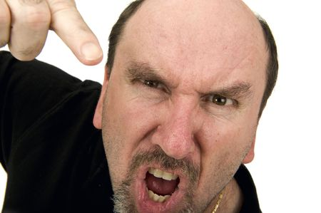 hit man: A middle age man yelling and pointing during an argurment.  Anger Managment??? Stock Photo