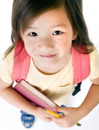 a young asian school girl ready for school Standard-Bild