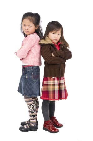 mad girl: Two young asian girls pouting over something