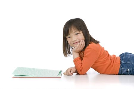 A young asian girl reading a book. On white