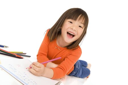 asian art: A young asian girl drawing a picture. On white