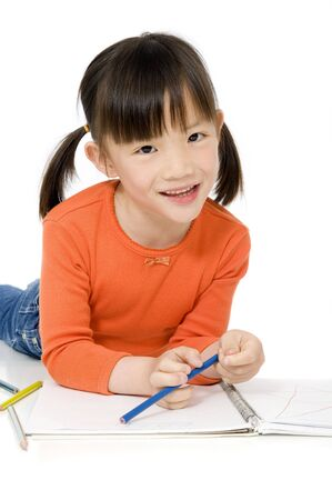 A young asian girl drawing a picture. On white