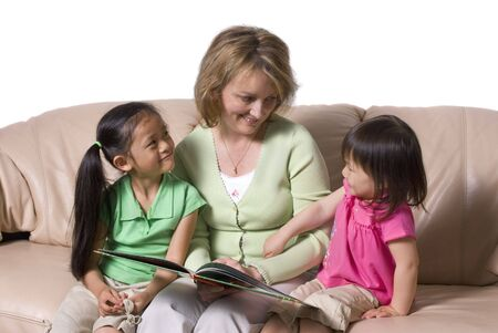 A young girl learns to write with the help of a teacher. Stock Photo - 5477116