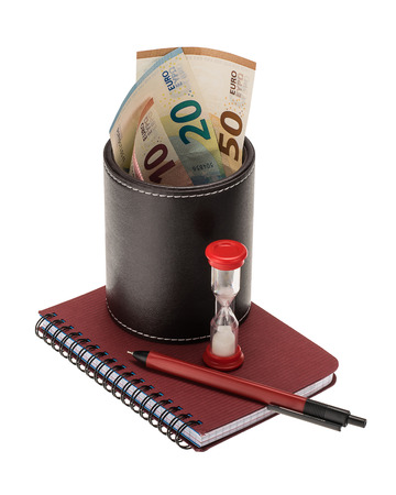 10, 20, 50 euro banknotes in a black leather holder, ballpoint pen, spiral notebook and hourglass isolated on white background