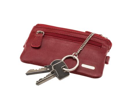 Custodia in pelle rosso scuro con due chiavi isolato su sfondo bianco Archivio Fotografico - 85333506