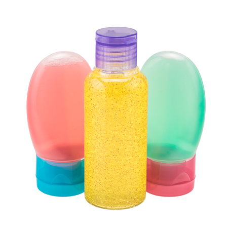 Colorful bottles with cosmetic products isolated over white