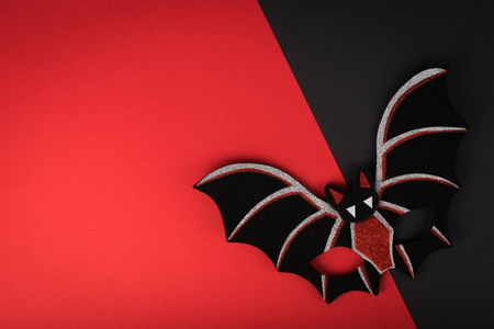 Halloween bat mask on black-red background 스톡 콘텐츠