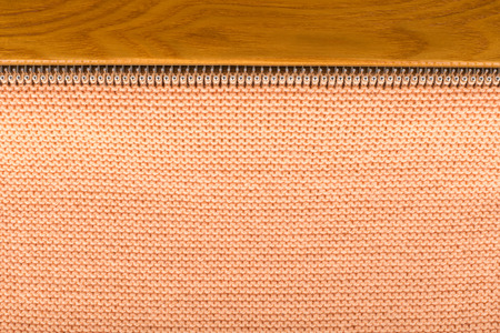Hand knitting machine, top view, knitted background