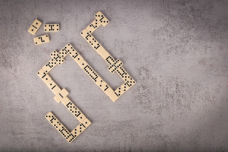 Double-six dominoes set on grey textured background, top view 스톡 콘텐츠