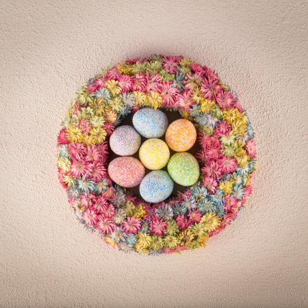 Easter wreath with eggs on light textured background 스톡 콘텐츠