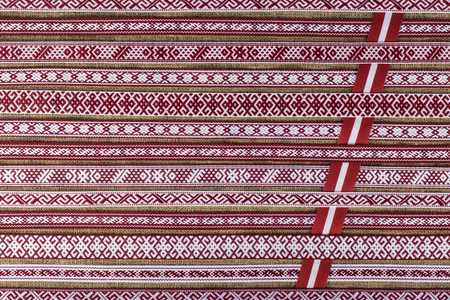 Latvian national style background with ornamented ribbons