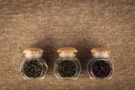 Different kinds of tea in small glass jars