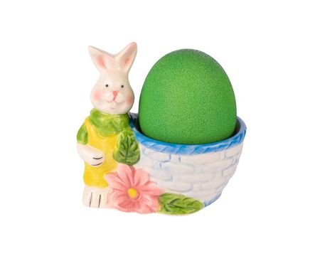 Ceramic rabbit figurine egg-cup with green painted egg