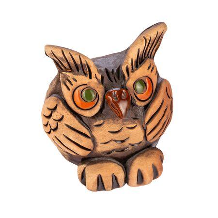 Decorative clay owl figurine, symbol of wisdom, isolated on white background 스톡 콘텐츠