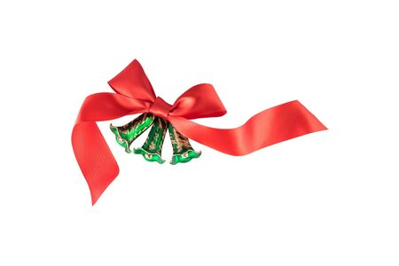 Green Christmas bells with a red bow on white background