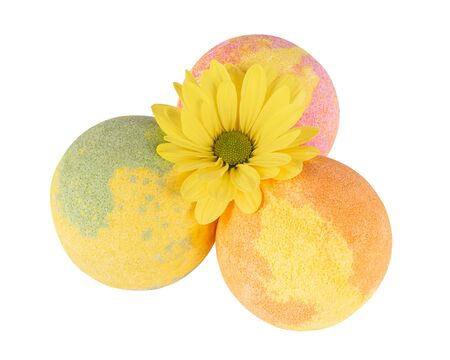 Composition of three bath bombs and yellow flower