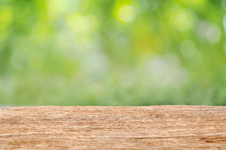 old wooden table with green nature bokeh background 版權商用圖片
