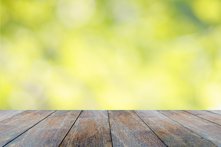 Wooden table with defocus nature green bokeh background 版權商用圖片 - 51202460