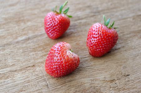 Fresh strawberries on wooden background