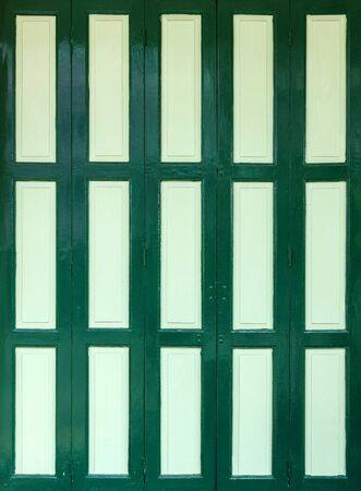 Antique green colored door, retro wood door 版權商用圖片 - 94651744